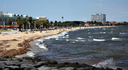 St Kilda, Australia - December 30, 2016. Hot sunny day in summertime on St Kilda beach. St Kilda beach in Melbourne is a popular place for swimming in the sea.