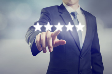 evaluation concept. Businessman pointing five star to increase rating of company, Increase rating.