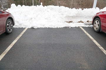 parking lot with snow removed and part of the car