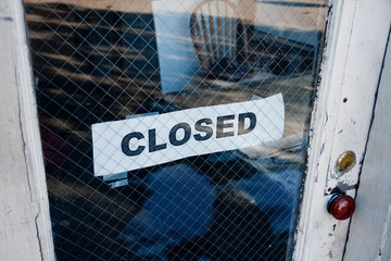 sign on a door business closed