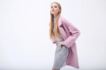 Young elegant woman in trendy pink coat. Wall mural