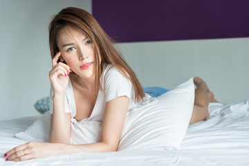Beautiful asian woman sexy on the bed.