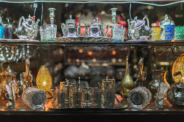 Moroccan metal lamps and ceramic in the shop