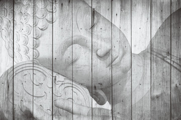 buddha face with color paint in wood background, peace vintage art decorate Thai style.