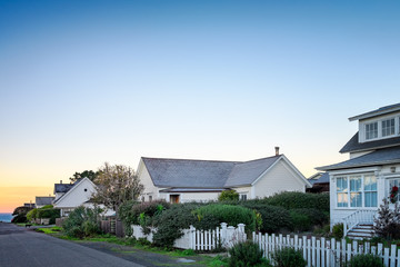Small town America houses with white picket fences at sunrise