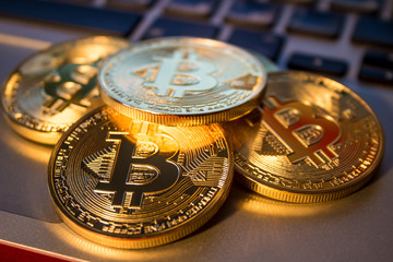 Photo Golden Bitcoins On laptop. Trading Concept Of Crypto Currency