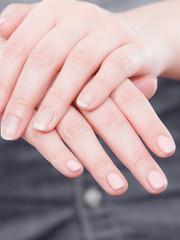 Woman presents hands nails.