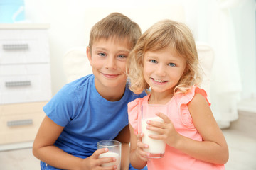 Portrait of boy and girl with milk glasses
