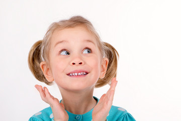 Funny girl kids smiling hands to her face