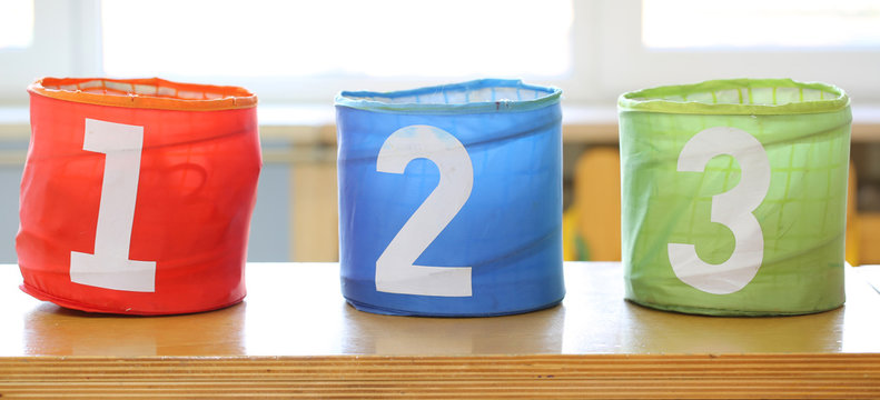 three large jars for toys with numbers one two three