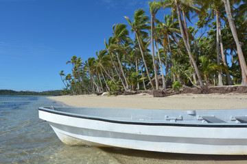 White fishing boat on a tropical island Fiji
