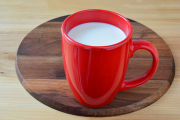 Red cup of fresh milk