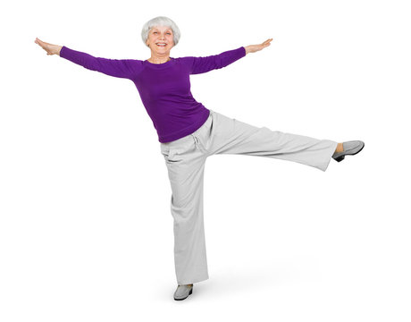 happy charming beautiful elderly woman doing exercises while working out playing sports. On a white background