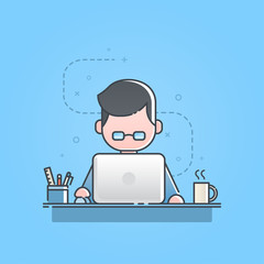 Young man sitting and working on laptop computer, Freelance work, home office.