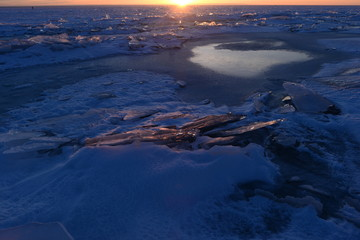 Finnish Bay of Baltic Sea Photo Landscape break thin ice in the light of sunset