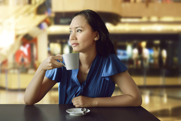 Young asian woman with a cup of tea