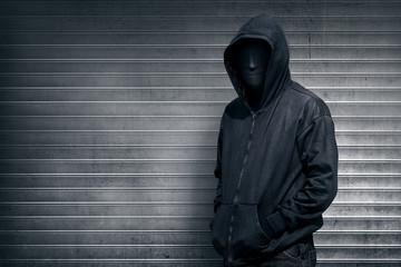 Anonymous man on grey shutter door