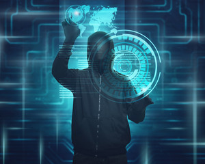 Hooded man with mask using virtual screen to hacking