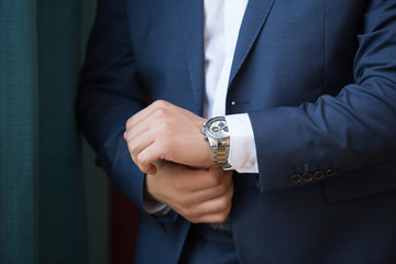 A close up of an expensive elegant watch on a hand of the business man. business concept