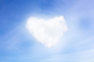 blue sky with hearts shape clouds. Valentine's holiday backgroun