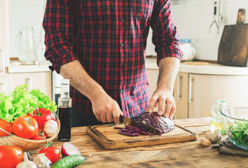 Man cooking in kitchen at home healthy food