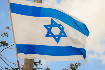 Flag of Israel over the sky at wind