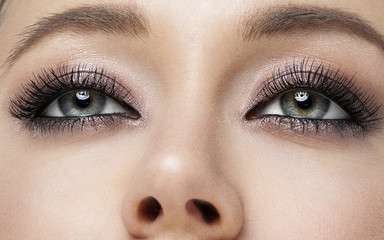 pretty girl make up smoky eyes black mascara close up beauty