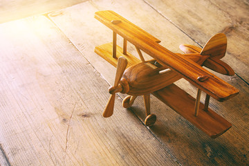 image of vintage old toy airplane over old table