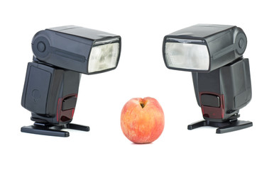 Two photo flashes and peach
