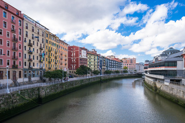 House facades in Bilbao along the Nervion river that runs through the city into the Cantabrian Sea. The apartment blocks are situated in the district San Frantzisko, on right the Mercado de la Ribera