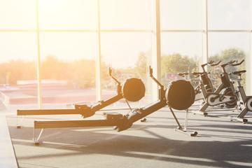 Modern gym interior with equipment, fitness leg exercise machine