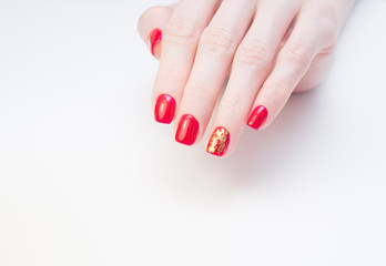 Amazing manicure and natural nails with gel polish. Attractive modern nail art design.