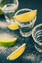Silver Mexican tequila with lime and salt, toned picture, selective focus, close up