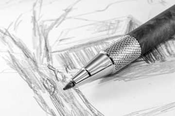 Black and white close up of mechanical pencil on artists sketch