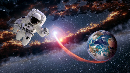 Astronaut planet Earth spaceman launch outer space suit galaxy universe. Elements of this image furnished by NASA.