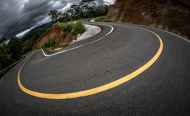 Amazing sharp bend, abrupt turn, winding, serpentine and circuitous route, mountain asphalt road with curve and yellow line