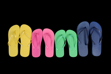 colorful flip flop sandals on black background