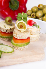 finger food with bread, peppers, cucumber, cheese and olives