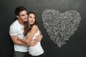 Happy young couple hugging and standing