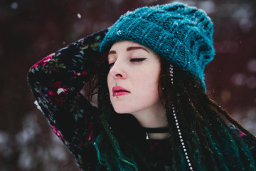 Very cute girl Yulia with snowflakes at winter