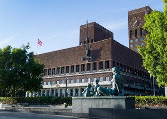 Oslo Town Hall with Norwegian flag.