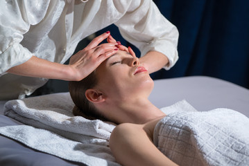 The woman is, she makes a facial massage