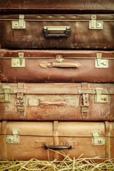 Vintage suitcases on hay
