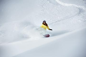 Girl snowboarder off-piste backcountry freeriding