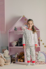 girl in pajamas in the children's room