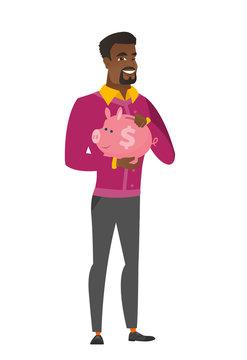African-american business man holding piggy bank