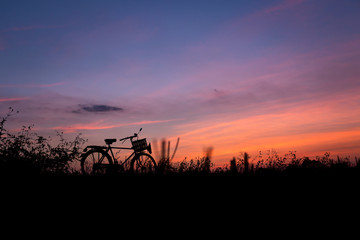 Bicycle silhouette in nature sunset golden hour evening with twi