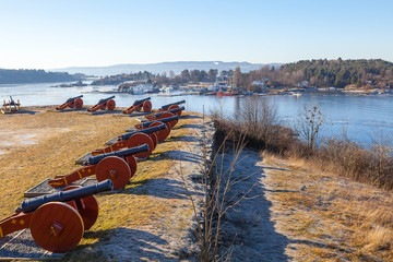 Old cannons of former fort on the Norwegian island near Oslo