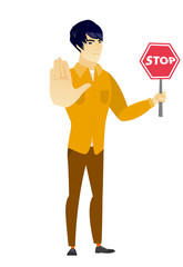 Asian businessman holding stop road sign.