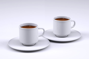 Two white coffee cup isolated on grey background